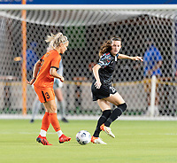 HOUSTON, TX - SEPTEMBER 10: Rachel Daly #3 of the Houston Dash passes the ball in front of Tierna Davidson #26 of the Chicago Red Stars during a game between Chicago Red Stars and Houston Dash at BBVA Stadium on September 10, 2021 in Houston, Texas.