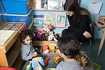 Education Preschool Childcare 2-3 year olds speech therapy session services provided by program, intern observing session with toddler boy