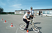 Police Officer working in the community teaching young schoolchildren cycling proficiency. This image may only be used to portray the subject in a positive manner..©shoutpictures.com..john@shoutpictures.com