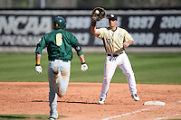 Central Florida Knights first baseman James Vasquez (13) takes a throw to force out Vincent Citro (6) during a game against the Siena Saints at Jay Bergman Field on February 16, 2014 in Orlando, Florida.  UCF defeated Siena 9-6.  (Mike Janes/Four Seam Images)