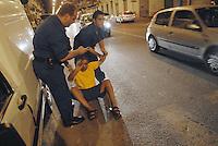 """- volunteers of  """"Blue Berets"""" association in security service for Milan Municipality in Padova street, neutralize a  drunk North African immigrant who  attacked them....- volontari dell'associazione """"Blue Berets"""" in servizio di sicurezza per il Comune di Milano in via Padova neutralizzano un immigrato nordafricano ubriaco che li aveva aggrediti"""