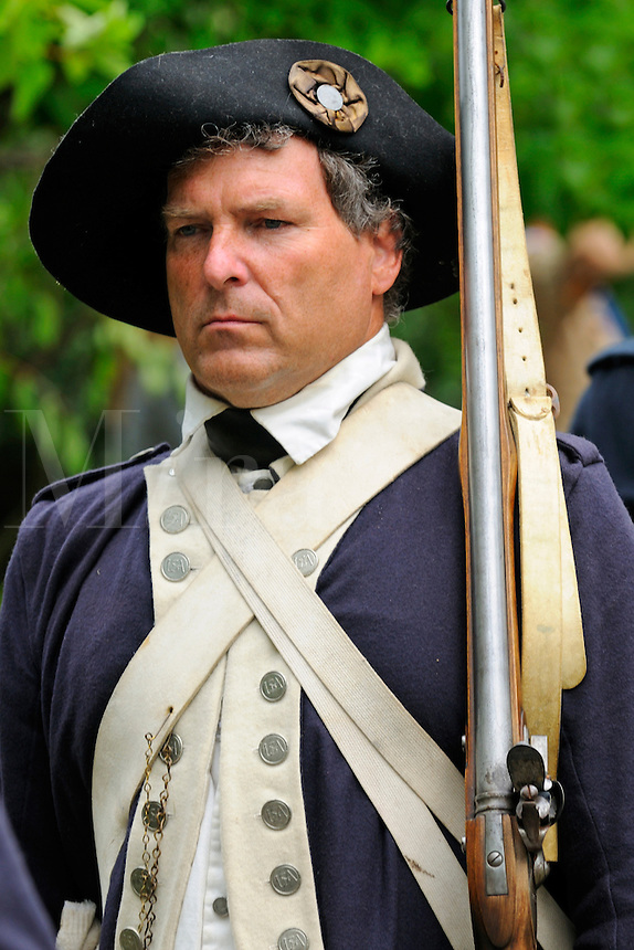 Soldier of the Sixth Connecticut Regiment, Company of Light Infantry, of the Continental Army, marches to the grave of Roger Sherman during July 4th ceremony to recognize fallen patriots in the War of Independence at Grove Street Cemetery, New Haven, Connecticut, USA.