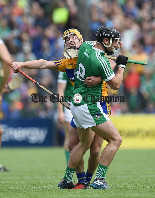 Colm Galvin of Clare in action against Darragh O Donovan of Limerick during their Munster championship game in Ennis. Photograph by John Kelly.