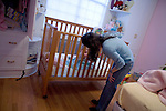 Rosaleen wakes her 1.5 year old son, Sean named after her brother, after she gets home from the WTC site..A day in the life of Rosaleen Tallon, sister of firefighter Sean Tallon killed in the 9/11 World Trade Center attacks. In response to the proposed WTC memorial being built underground at the site, Ms. Tallon has been sleeping for 16 days in front of the fire house across from the WTC site. She and several other WTC families are protesting the memorial design and asking for the victim's names to be placed above ground for the sake of honoring the lives lost and safety concerns with any possible future evacuation of the site.
