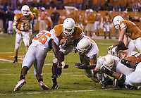 04 November 2006: Texas back Jamaal Charles (#25) tries to escape a tackle by Oklahoma State defenders during the Longhorns 36-10 victory over the Oklahoma State University Cowboys at Darrel K Royal Memorial Stadium in Austin, Texas.