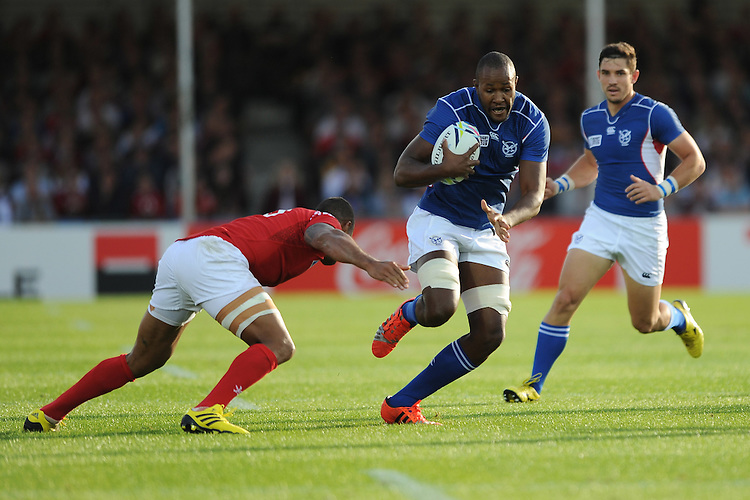 Tjiuee Uanivi of Namibia is tackled by Joseph Tuineau of Tonga during Match 20 of the Rugby World Cup 2015 between Tonga and Namibia - 29/09/2015 - Sandy Park, Exeter<br /> Mandatory Credit: Rob Munro/Stewart Communications