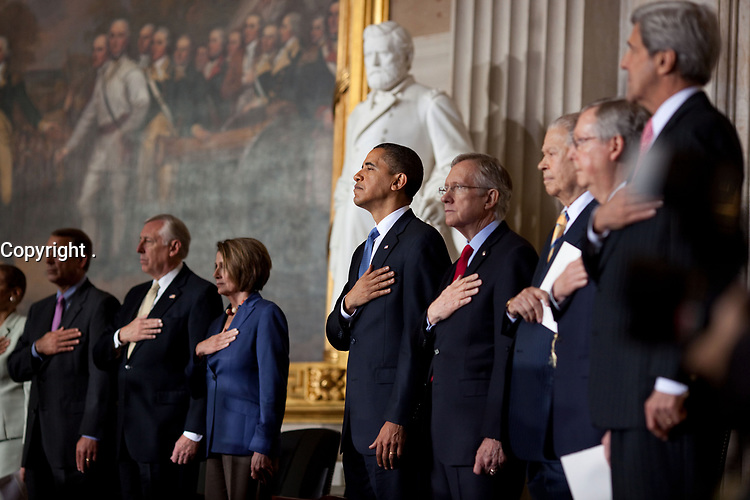President Barack Obama and Members of Congress stand for the national anthem during the Congressional Gold  Medal presentation to former Sen. Edward W. Brooke at the U.S. Capitol in Washington, D.C., Oct. 28, 2009. (Official White House Photo by Lawrence Jackson)<br /> <br /> This official White House photograph is being made available only for publication by news organizations and/or for personal use printing by the subject(s) of the photograph. The photograph may not be manipulated in any way and may not be used in commercial or political materials, advertisements, emails, products, promotions that in any way suggests approval or endorsement of the President, the First Family, or the White House.
