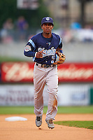 Corpus Christi Hooks second baseman Tony Kemp (7) jogs to the dugout during a game against the Arkansas Travelers on May 29, 2015 at Dickey-Stephens Park in Little Rock, Arkansas.  Corpus Christi defeated Arkansas 4-0 in a rain shortened game.  (Mike Janes/Four Seam Images)