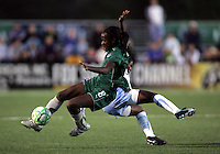 Tina Elerson (8) collides with Karen Carney..Saint Louis Athletica were defeated 1-0 by Chicago Red Stars in which was both teams inaugural game, played at Korte Stadium, Edwardsville, Illinois  on April 4, 2009.