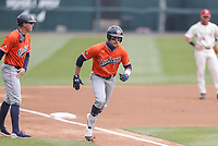 Auburn outfielder Judd Ward (1) scores a run, Saturday, April 3, 2021 during the first inning of a baseball game at Baum-Walker Stadium in Fayetteville. Check out nwaonline.com/210404Daily/ for today's photo gallery. <br /> (NWA Democrat-Gazette/Charlie Kaijo)