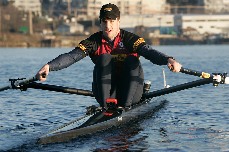 Rowing, single sculler Conal Groom at the catch, , Lake Union, Seattle, Washington State, Pacific Northwest,..