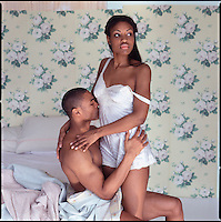 African American couple embracing at end of bed