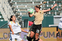 Kristen Graczyk #13 of  FC Gold Pride stops a pass from getting to Han Duan #9 of the Los Angeles Sol during their WPS game at The Home Depot Center on June 21,2009 in Carson, California.  The Sol defeated the Pride 2-0.