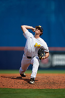 Michigan Wolverines relief pitcher Troy Miller (27) delivers a pitch during a game against Army West Point on February 18, 2018 at Tradition Field in St. Lucie, Florida.  Michigan defeated Army 7-3.  (Mike Janes/Four Seam Images)