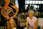 Package holiday 'Young at Heart', 1980s. Magaluf, Majorca, Spain. Senior lady showing me her holiday tan.
