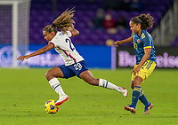 ORLANDO, FL - JANUARY 18: Catarina Macario #29 of the USWNT is fouled by Gisela Robledo #10 of Colombia during a game between Colombia and USWNT at Exploria Stadium on January 18, 2021 in Orlando, Florida.