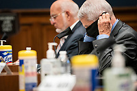 Anthony Fauci, director of the National Institute of Allergy and Infectious Diseases, adjusts a face mask as he testifies before the House Energy and Commerce Committee in Washington, D.C., U.S., on Tuesday, June 23, 2020. Trump administration health officials will tell lawmakers that their agencies are preparing for a flu season that will be complicated by the coronavirus pandemic.<br /> Credit: Sarah Silbiger / Pool via CNP/AdMedia