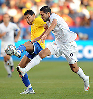 Clint Dempsey (8) of USA and Miranda (left) of Brazil. Brazil defeated USA 3-0 during the FIFA Confederations Cup at Loftus Versfeld Stadium in Tshwane/Pretoria, South Africa on June 18, 2009.