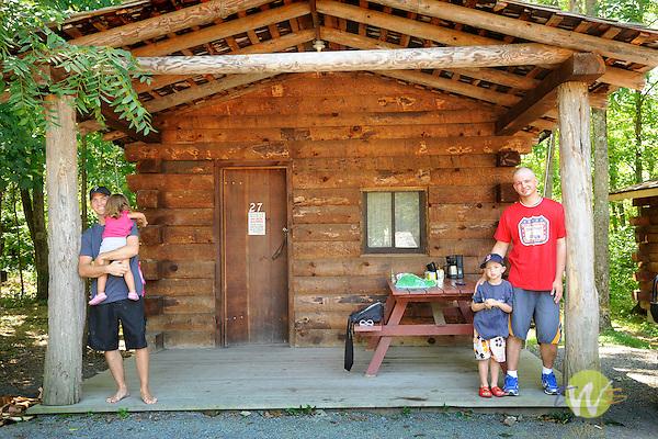 Knoebels Grove Amusement Park, Elysburg, PA. Release 0088. Family on cabin porch