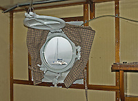 Catamaran Sail Boat through porthole window