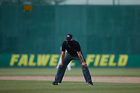 Umpire Mike Mackey handles the calls on the bases during the minor league baseball game between the Myrtle Beach Pelicans and the Lynchburg Hillcats at Bank of the James Stadium on May 23, 2021 in Lynchburg, Virginia. (Brian Westerholt/Four Seam Images)