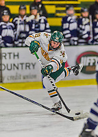 14 February 2015: University of Vermont Catamount Forward Brittany Zuback, a Senior from Thunder Bay, Ontario, takes a shot in the first period against the University of New Hampshire Wildcats at Gutterson Fieldhouse in Burlington, Vermont. The Lady Catamounts rallied from a 3-1 deficit to earn a 3-3 tie in the final home game of their NCAA Hockey East season. Mandatory Credit: Ed Wolfstein Photo *** RAW (NEF) Image File Available ***