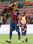FC Barcelona's Neymar Santos Jr celebrates with his son the victory in the Spanish King's Cup Final match. May 30,2015. (ALTERPHOTOS/Acero)