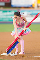 "The ""Tooth Fairy"" cleans third base between innings of the Eastern League game between the Akron Rubber Ducks and the Reading Fightin Phils at FirstEnergy Stadium on June 19, 2014 in Reading, Pennsylvania.  The Rubber Ducks defeated the Fightin Phils 3-2.  (Brian Westerholt/Four Seam Images)"