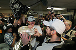 12 June 2009: Pittsburgh Penguins center Sidney Crosby (87) helps left wing Chris Kunitz (14) drink champagne from the Stanley Cup Trophy in the team dressing room, after game seven of the NHL Stanley Cup Finals between the Pittsburgh Penguins and Detroit Red Wings, at Joe Louis Arena, in Detroit, Michigan. Pittsburgh won 2-1 to clinch the title...***** Editorial Use Only *****