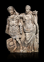 Roman Sebasteion relief  sculpture of Nero being crowned emperor by Agrippina, Aphrodisias Museum, Aphrodisias, Turkey.   Against a black background.<br /> <br /> Agrippina crowns her young son Nero with a laurel wreath. She carries a cornucopia, a symbol of Fortune and Plenty, and he wears the armour and cloak of a Roman commander, with a helmet on the ground near his feet. The scene refers to Nero's accession as emperor in AD 54, and belongs before AD 59 when Nero had Agrippina murdered.