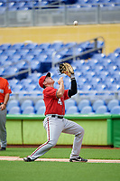 Washington Nationals first baseman KJ Harrison (4) settles under a pop up during a Florida Instructional League game against the Miami Marlins on September 26, 2018 at the Marlins Park in Miami, Florida.  (Mike Janes/Four Seam Images)