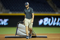 A member of the Durham Bulls grounds crew drags the infield between innings of the game against the Louisville Bats at Durham Bulls Athletic Park on May 28, 2019 in Durham, North Carolina. The Bulls defeated the Bats 18-3. (Brian Westerholt/Four Seam Images)
