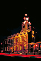 Night view of Independence Hall shows lighting and car light streaks. Philadelphia Pennsylvania United States.