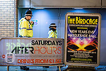 """© Joel Goodman - 07973 332324 . NO SYNDICATION PERMITTED . 19/12/2014 . Manchester , UK . Police attend at the Bird Cage on Withy Grove . """" Mad Friday """" revellers out in the rain and cold in Manchester . Mad Friday is typically the busiest day of the year for emergency services , taking place on the last Friday before Christmas when office Christmas parties and Christmas revellers enjoy a night out .  Photo credit : Joel Goodman"""