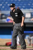 Umpire Matt Carlyon gets in position to make a call during a game between the State College Spikes and Batavia Muckdogs on June 22, 2014 at Dwyer Stadium in Batavia, New York.  State College defeated Batavia 10-3.  (Mike Janes/Four Seam Images)