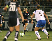 Allie Long #9 of the Washington Freedom closes in on Maggie Tomecks #5 of the Boston Breakers during a WPS match at Maryland Soccerplex on July 29, in Boyds, Maryland. Freedom won 1-0.