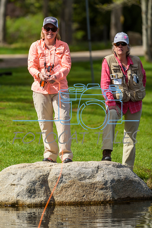River Buddy Carol Birchill, right, assists Laura Diko during the Casting for Recovery fishing clinic at Bently Ranch in Gardnerville, Nev. May 4, 2018.<br /> Photo by Candice Vivien/Nevada Momentum