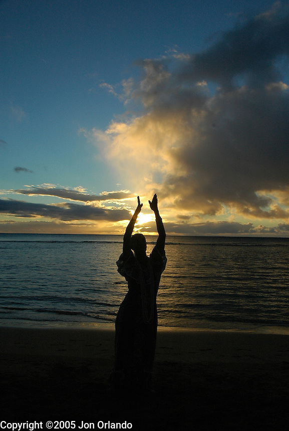 Hula dancer at sunset on the island of Kauai.  Shot on location for Idanha Films.