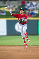 Memphis Redbirds second baseman Greg Garcia #5 makes a running throw to first base during the Pacific Coast League baseball game against the Round Rock Express on April 24, 2014 at the Dell Diamond in Round Rock, Texas. The Express defeated the Redbirds 6-2. (Andrew Woolley/Four Seam Images)