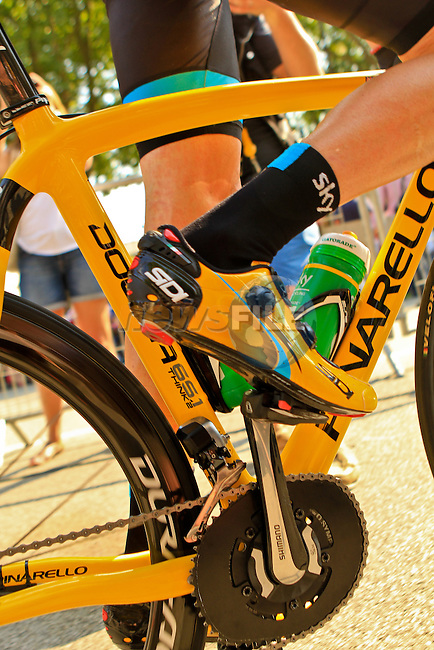 Rcae leader Chris Froome (GBR) aboard his yellow liveried Sky Procycling team Pinarello bike makes his way to sign on before the start of the Final Stage 21 of the 100th Edition of the 2013 Tour de France from Versailes to Paris Champs-Elysees. 21st July 2013.<br /> (Photo:Thomas van Bracht / Peloton Photos/www.newsfile.ie)