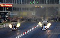 Jul, 20, 2012; Morrison, CO, USA: NHRA top fuel dragster driver Brandon Bernstein (right) races alongside Doug Kalitta during qualifying for the Mile High Nationals at Bandimere Speedway. Mandatory Credit: Mark J. Rebilas-US PRESSWIRE