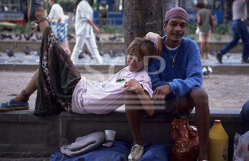 Rio de Janeiro, Brazil. Street kid couple with their belongings on a street.