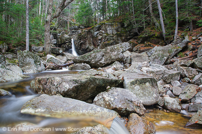 Kinsman Falls on Cascade Brook in Lincoln, New Hampshire during the autumn months. These falls are located along the Basin-Cascades Trail, and are also known as Basin Falls and Tunnel Falls.