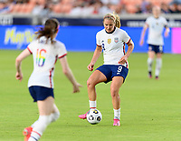 HOUSTON, TX - JUNE 10: Lindsey Horan #9 of the United States passes the ball to a teammate during a game between Portugal and USWNT at BBVA Stadium on June 10, 2021 in Houston, Texas.