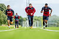 Wednesday 26 July 2017<br /> Pictured: ( L-R ) Tom Carroll of Swansea City, Gylfi Sigurdsson and  Kyle Bartley during training <br /> Re: Swansea City FC Training session takes place at the Fairwood Training Ground, Swansea, Wales, UK