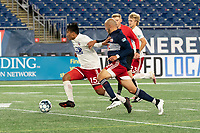 FOXBOROUGH, MA - OCTOBER 16: Dominick Hernandez #15 of North Texas SC and Tiago Mendonca #33 of New England Revolution II battle for the ball during a game between North Texas SC and New England Revolution II at Gillette Stadium on October 16, 2020 in Foxborough, Massachusetts.