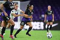 ORLANDO, FL - SEPTEMBER 11: Marta #10 of the Orlando Pride dribbles the ball during a game between Racing Louisville FC and Orlando Pride at Exploria Stadium on September 11, 2021 in Orlando, Florida.