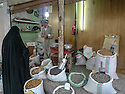 Iraq 2011  <br />  In the old souk of Erbil, seller of grains and spices and a veiled woman  <br /> Irak 2011  <br /> Dans le vieux souk d'Erbil, le vendeur d'epices et de grains et une femme voilee
