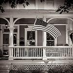 PATRIOTIC PORCH -- Taken in Lake Geneva, Wisconsin, USA.  #michaelknapstein #midwestmemoir #blackandwhite #B&W #monochrome #motherfstop #wisconsin  #bwphotography #myfeatureshoot  #fineartphotography #americanmidwest #squaremag #lensculture #mifa #moscowfotoawards #moscowinternationalfotoawards #rps #royalphotographicsociety #CriticalMass #CriticalMassTop200 #photolucida  #portfolioshowcase11 #thegalaawards #thepolluxawards #flakphoto #ipe160 #ipe161 #grainedephotographe  #galleryofwisconsinart