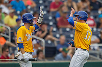 UC Santa Barbara Gauchos shortstop Clay Fisher (17) is greeted by teammate Billy Fredrick (26) after scoring against the Miami Hurricanes in Game 5 of the NCAA College World Series on June 20, 2016 at TD Ameritrade Park in Omaha, Nebraska. UC Santa Barbara defeated Miami  5-3. (Andrew Woolley/Four Seam Images)